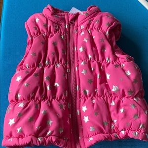 Pink puffy vest